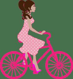 Девушка в платье едет на новом велосипеде
